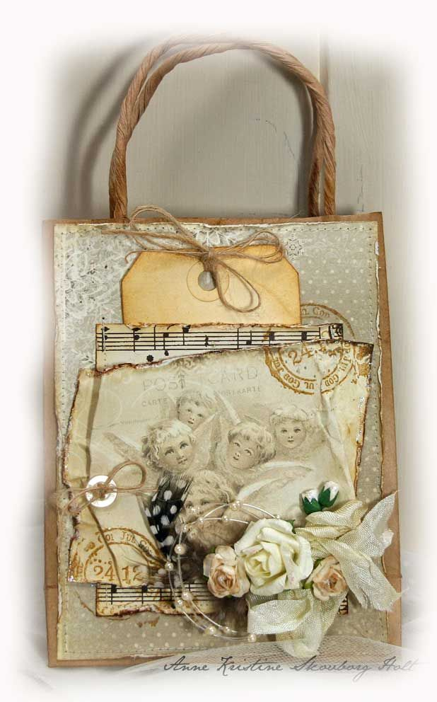 Anne's paper fun mixed media paper bag craft.    paper bag, ribbon, fake foliage, aged tag, thread, antique style print, printed music paper, old stamp from post office.