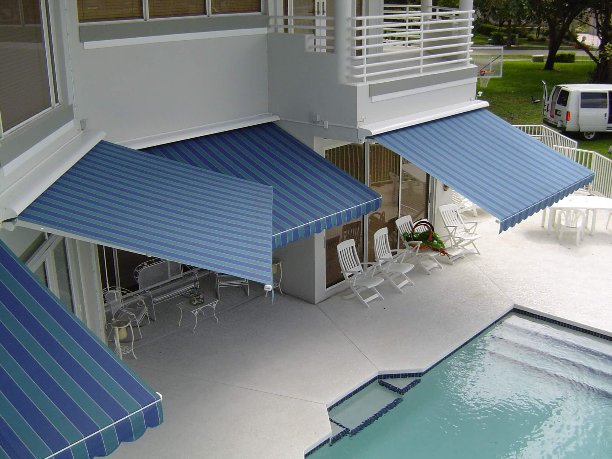 dual relaxing retractable innovative pool patio durasol openings under arm awnings shades lateral with awning