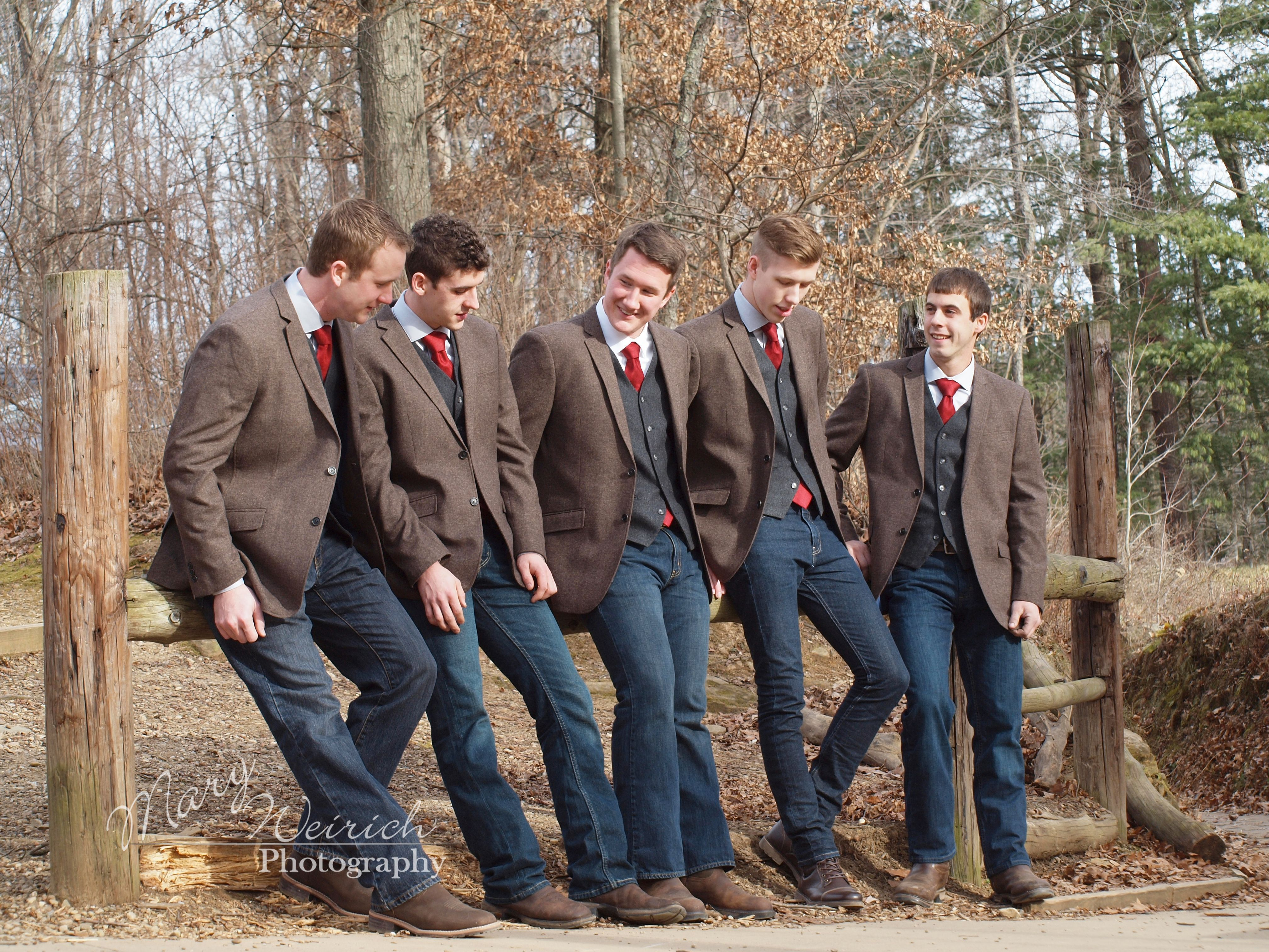 Groom and Groomsmen in casual wedding attire. Jeans, brown jackets ...