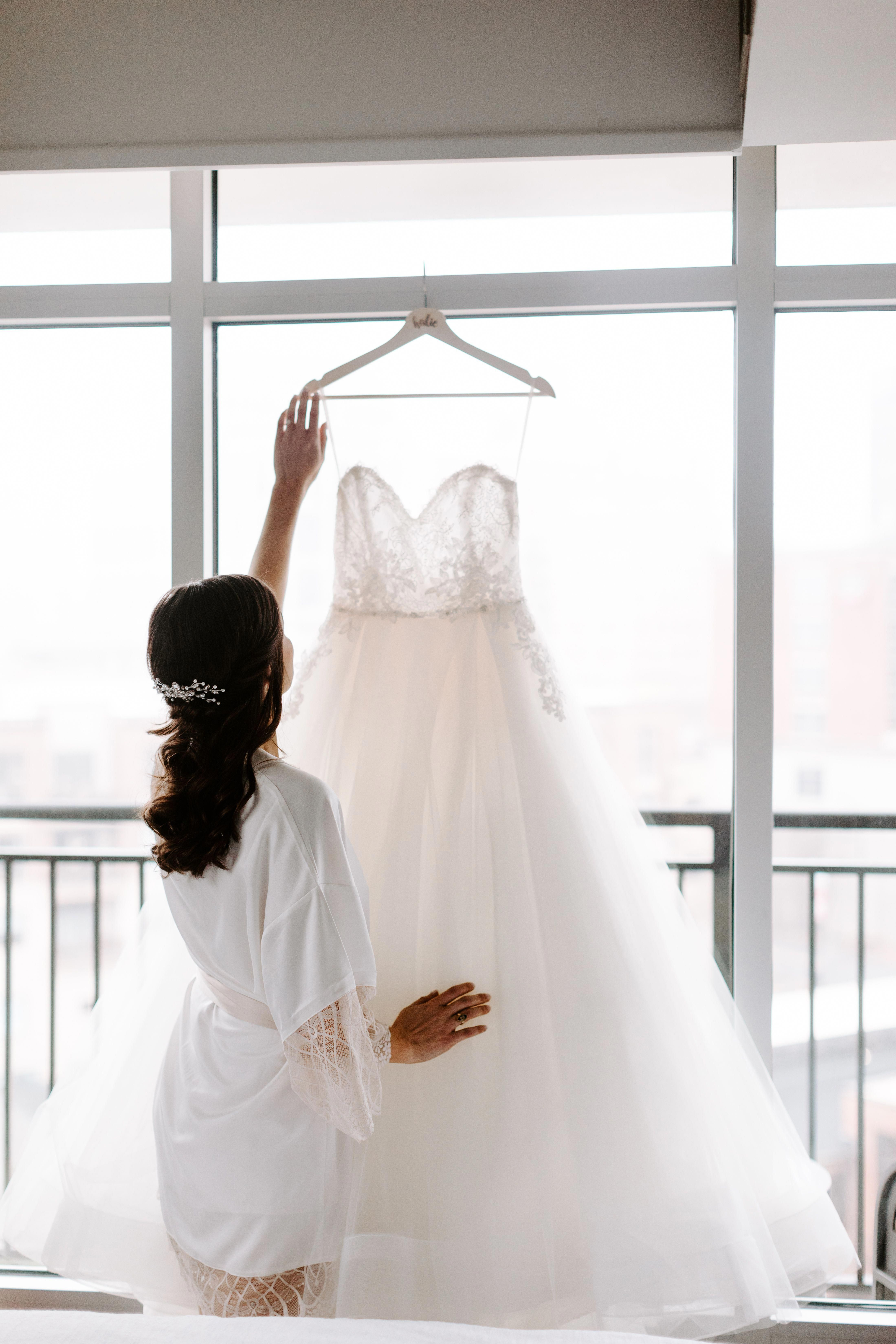 Bride getting ready on wedding day. Wedding dress picture