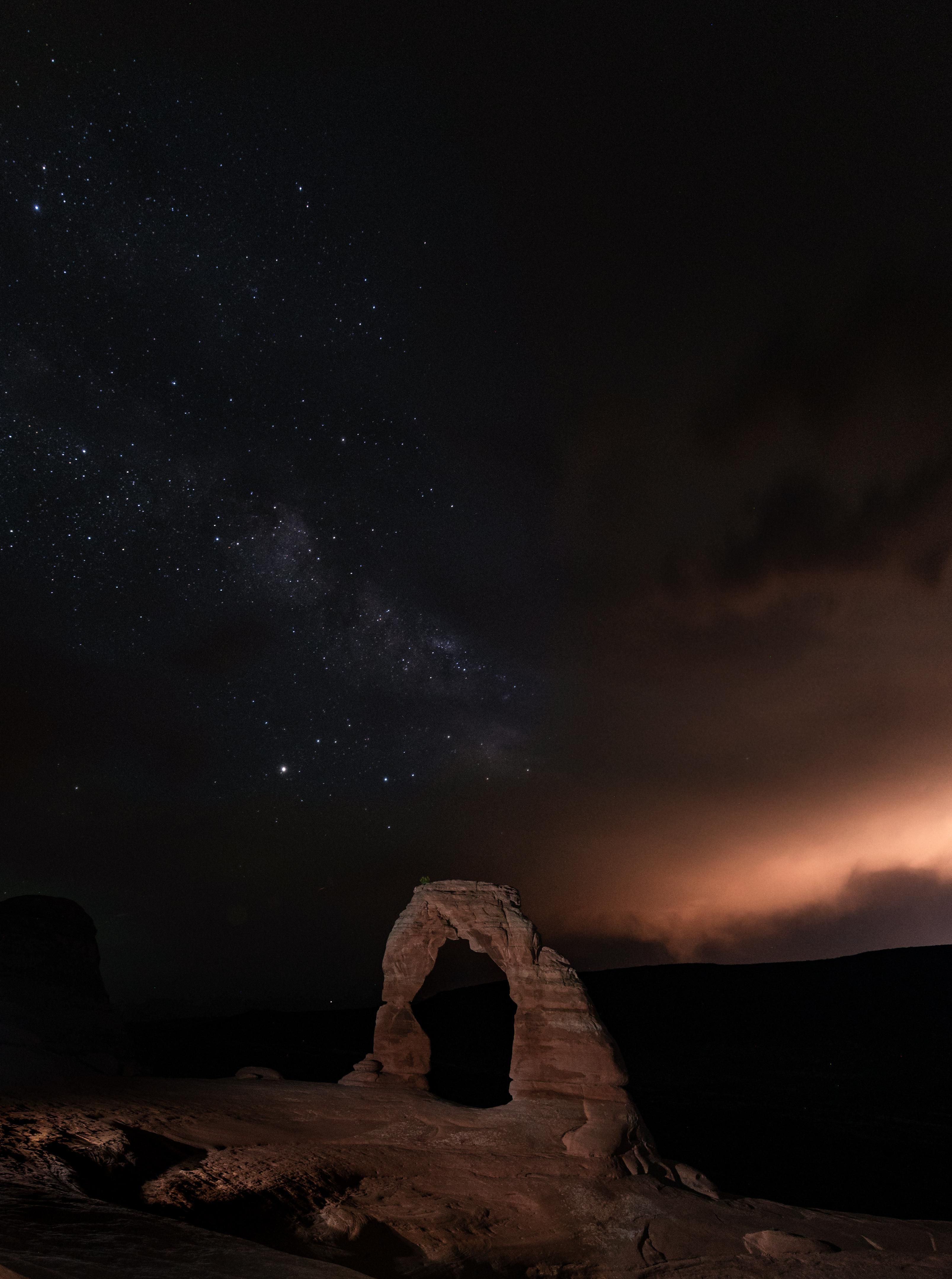 Close Up View Of Delicate Arch On A Very Cloudy Night