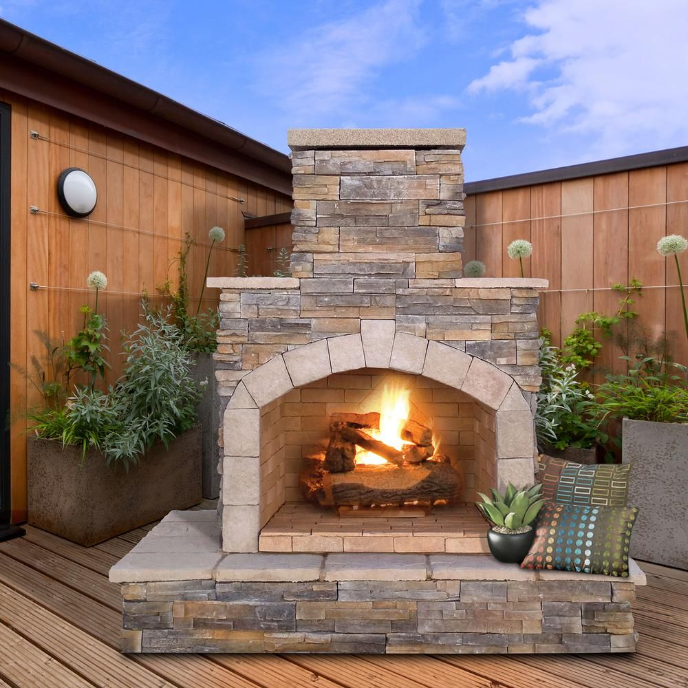 Cal flame in brown cultured stone propane gas outdoor fireplace
