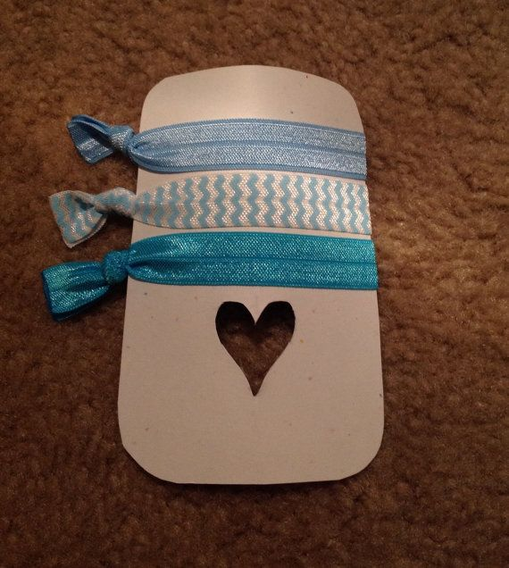 Set of 3 blue hair ties. Stretchy and comfy. Wont pull at your hair. Perfect for any occasion.