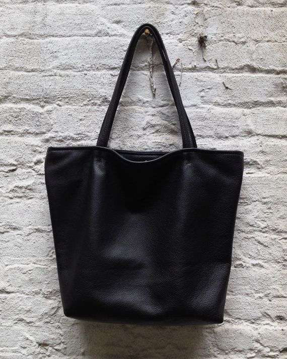 f1db38954ca Black pebbled calfskin bag with a canvas waterproof lining. No bottom  seam—just one piece of leather. Inside  two leather edged slip pockets