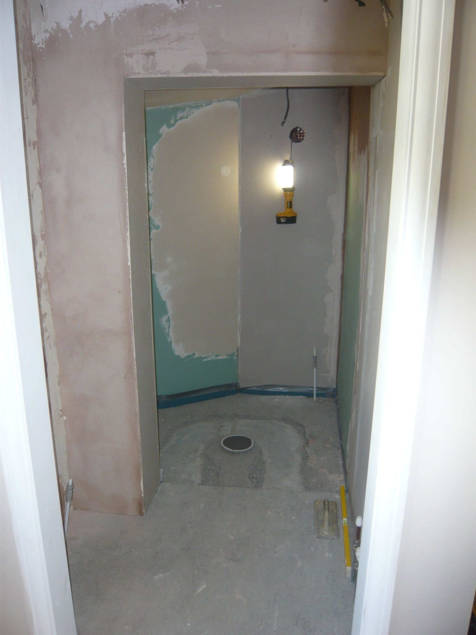 Creation of wet floor area, with damp proof membrane.