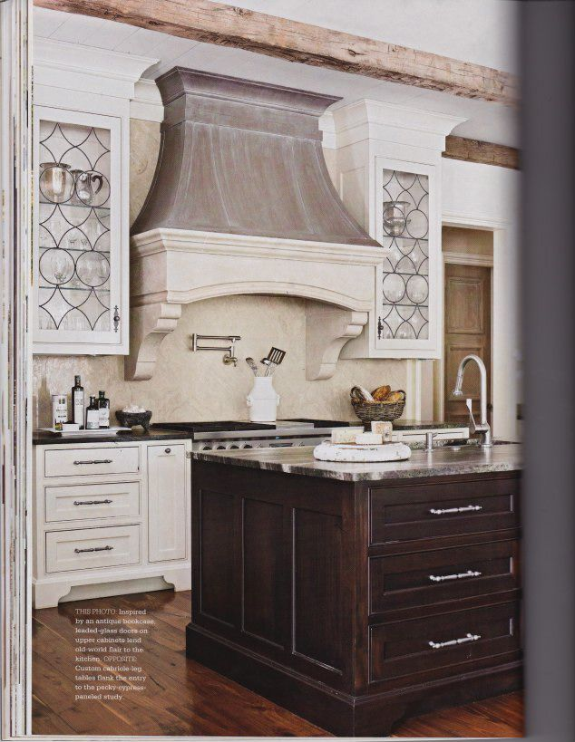 kitchen hood cabinet range flanked by symmetrical glass cabinets 21746