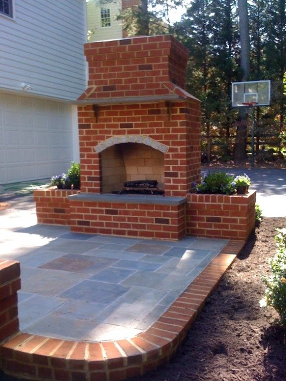 I love outdoor fireplaces. Cute idea to go with the pergola and ...