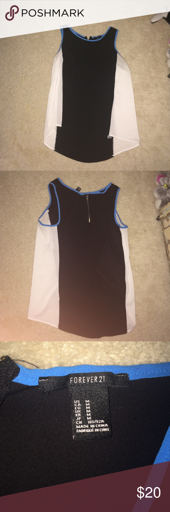 """Black, White, and Blue Tank This high low tank from Forever 21 is perfect for dressing up or dressing down! Soft and adorable. Worn maybe two or three times, in new, excellent condition. I'm 5'4"""" and the front comes to the hem of my jeans and in the back goes to the middle of my butt. ❤️ OPEN TO TRADES ❤️ Forever 21 Tops Blouses"""