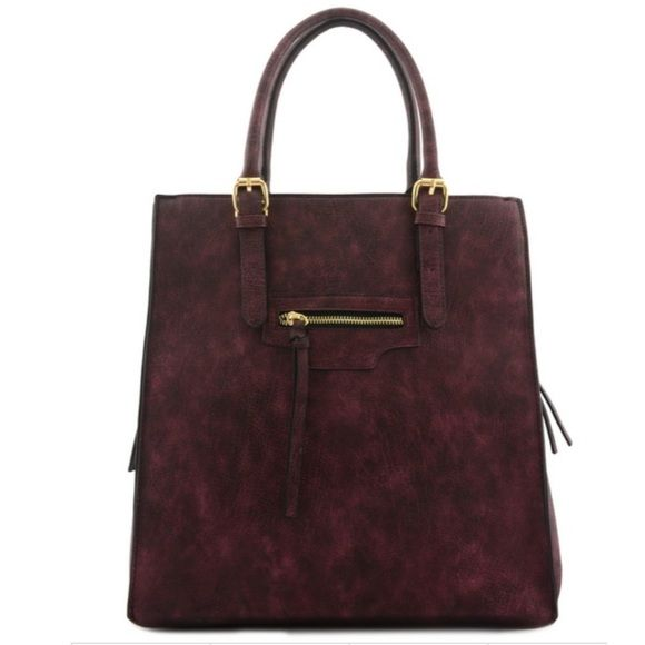 Women's vegan tote bag Women's burgundy tote bag. Zipper top closure Textured faux leather Rear zipper pocket Inside lining with zipper pocket 20 inch handle & 52 inch adjustable strap 14 (W) x 6 (D) x 14 (H) inches Bags Totes