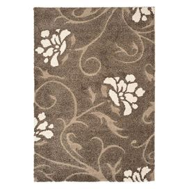 "Stylishly anchor your dining set or living room seating group with this lovely shag rug, showcasing a floral-inspired motif in smoke and beige.  Product: RugConstruction Material: PolypropyleneColor: Smoke and beigeFeatures:  Dense shag pile1"" Pile heightDurable cotton canvas backing High-low pile constructionNote: Please be aware that actual colors may vary from those shown on your screen. Accent rugs may also not show the entire pattern that the corresponding area rugs have.Cleaning and…"