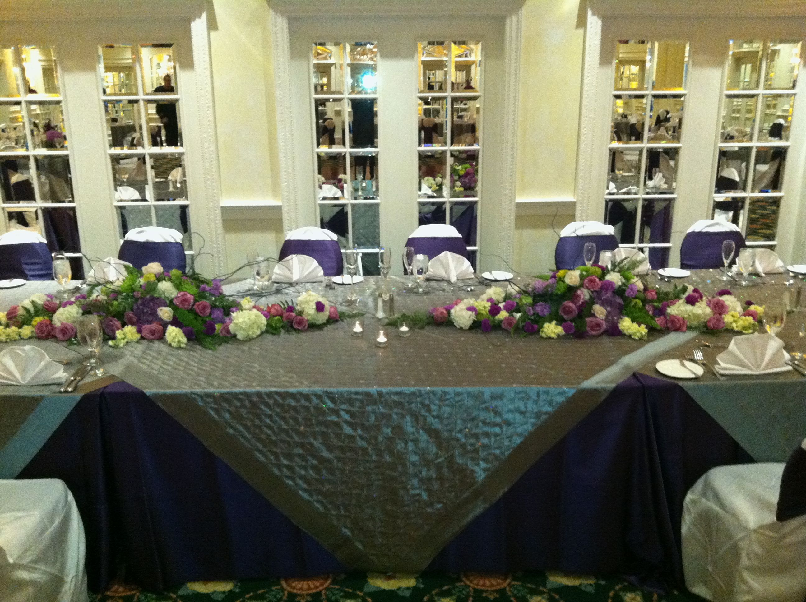 Table settings and this specifically is our head table.Notice the purple on the chairs & Table settings and this specifically is our head table.Notice the ...