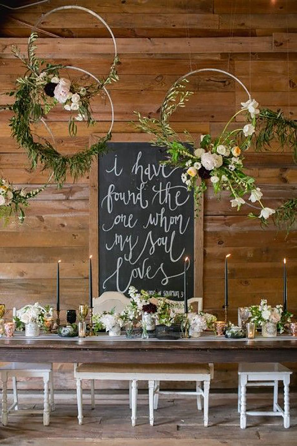 Hanging flower decorations above a wedding table