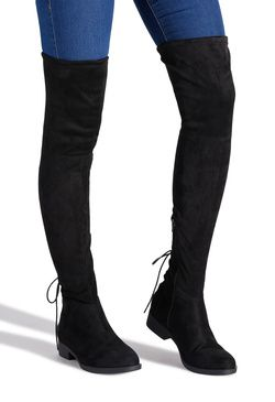 07210218cdfc This flat, thigh-high boot features a back corset detail at the ankle.