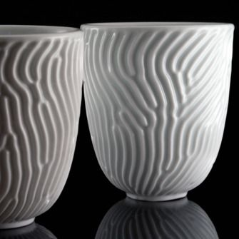 Reaction Cup by Nervous System via design-milk: Made of porcelain, the form is the result of a computer simulation of reaction-diffusion, a natural patterning process that creates the dots and stripes seen on the skins and shells of many animals from tropical fish to zebras and leopards.  #Cups #Nervous_System #Reaction_Diffusion #design_milk