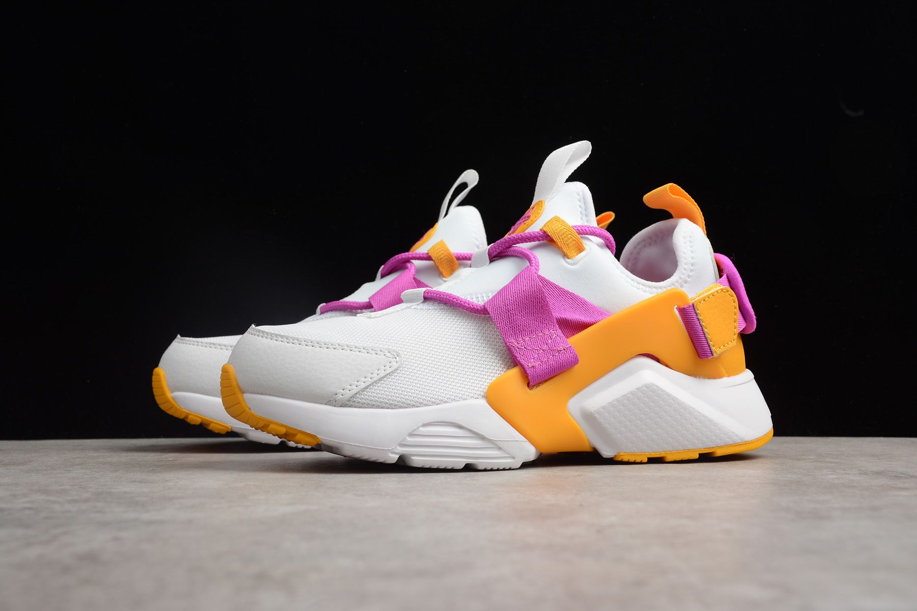 c84b6cf46d11d Women s Nike Air Huarache City Low Fuschia White AH6804-102 in 2019 ...