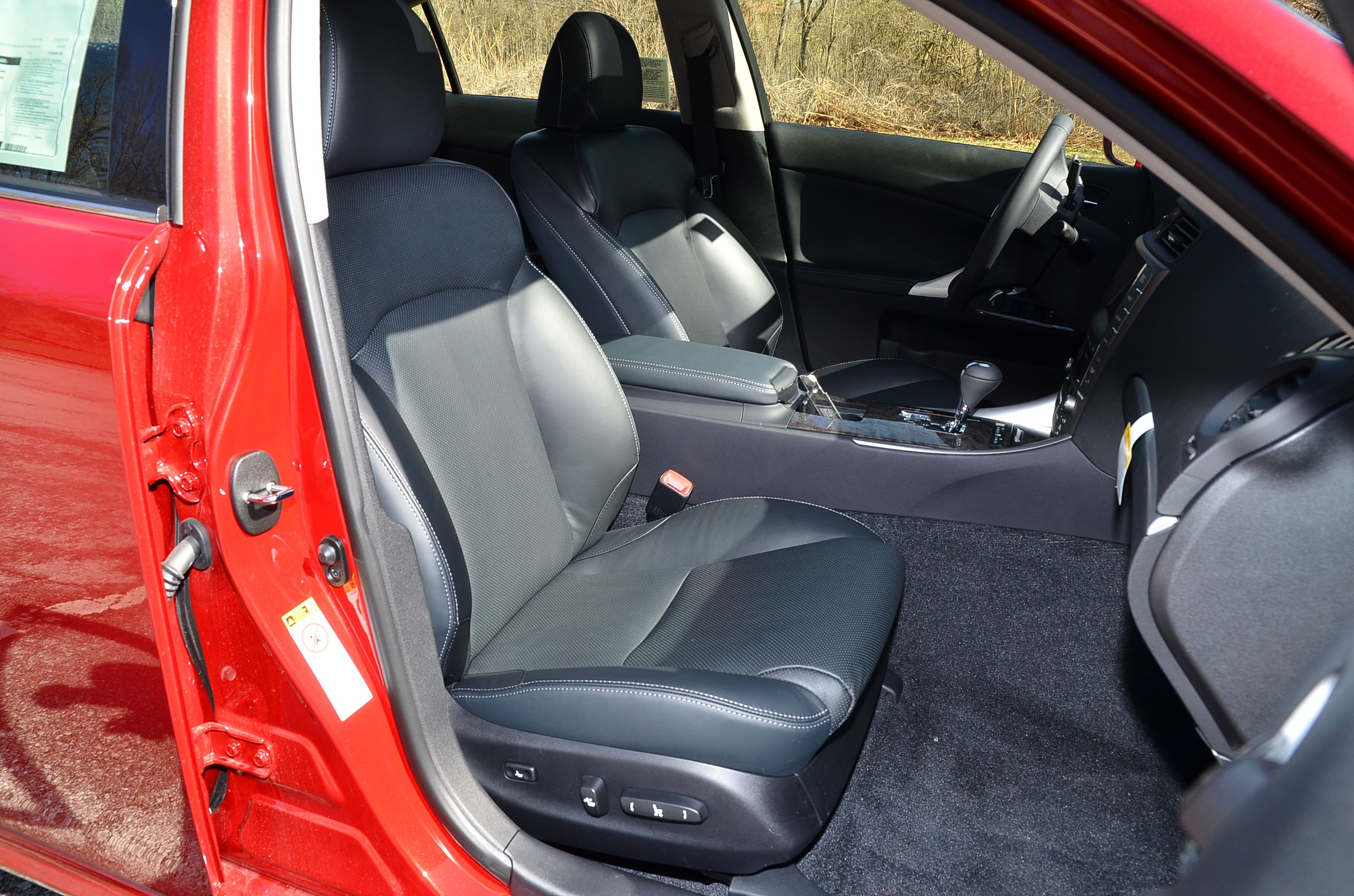 2012 lexus is in matador red mica with black leather