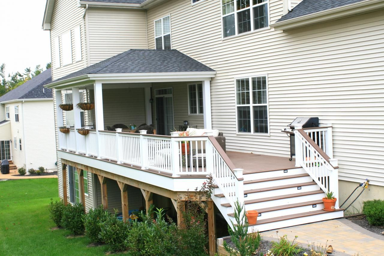 Hip Style Roof With White Vinyl Columns Azek Acacia Deck
