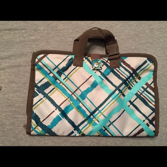 ThirtyOne Jewelry Holder. Perfect condition. Each department has an additional hidden pocket behind it along with the visible one. Folds up easily even when full. Has a latch for connecting to suitcases and such. Super convenient and cute! ThirtyOne Jewelry