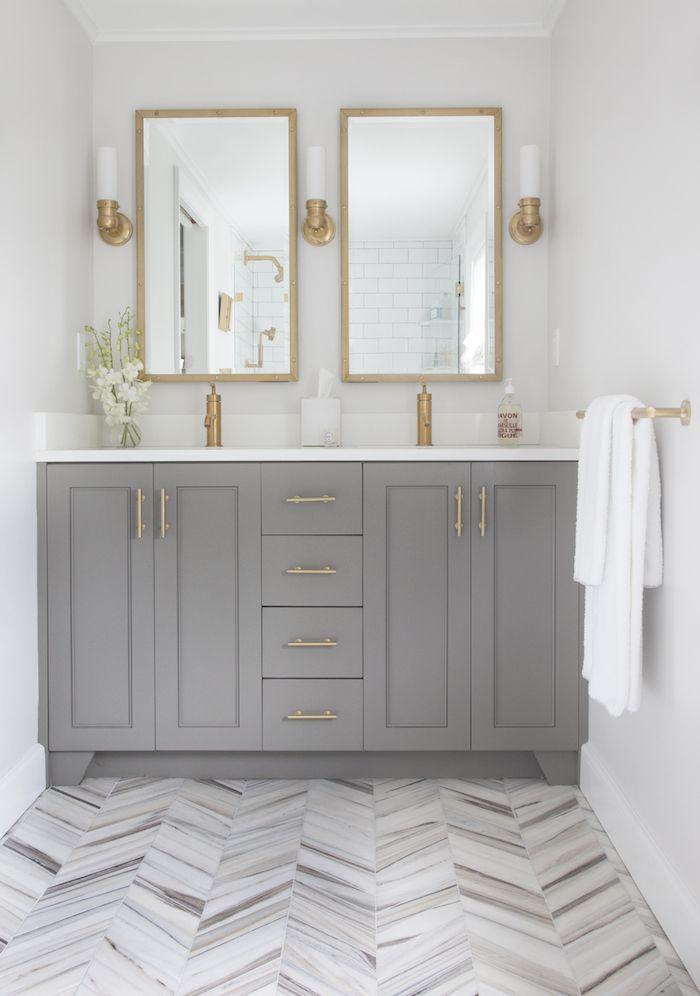 Grey vanity white countertop herringbone tile floor
