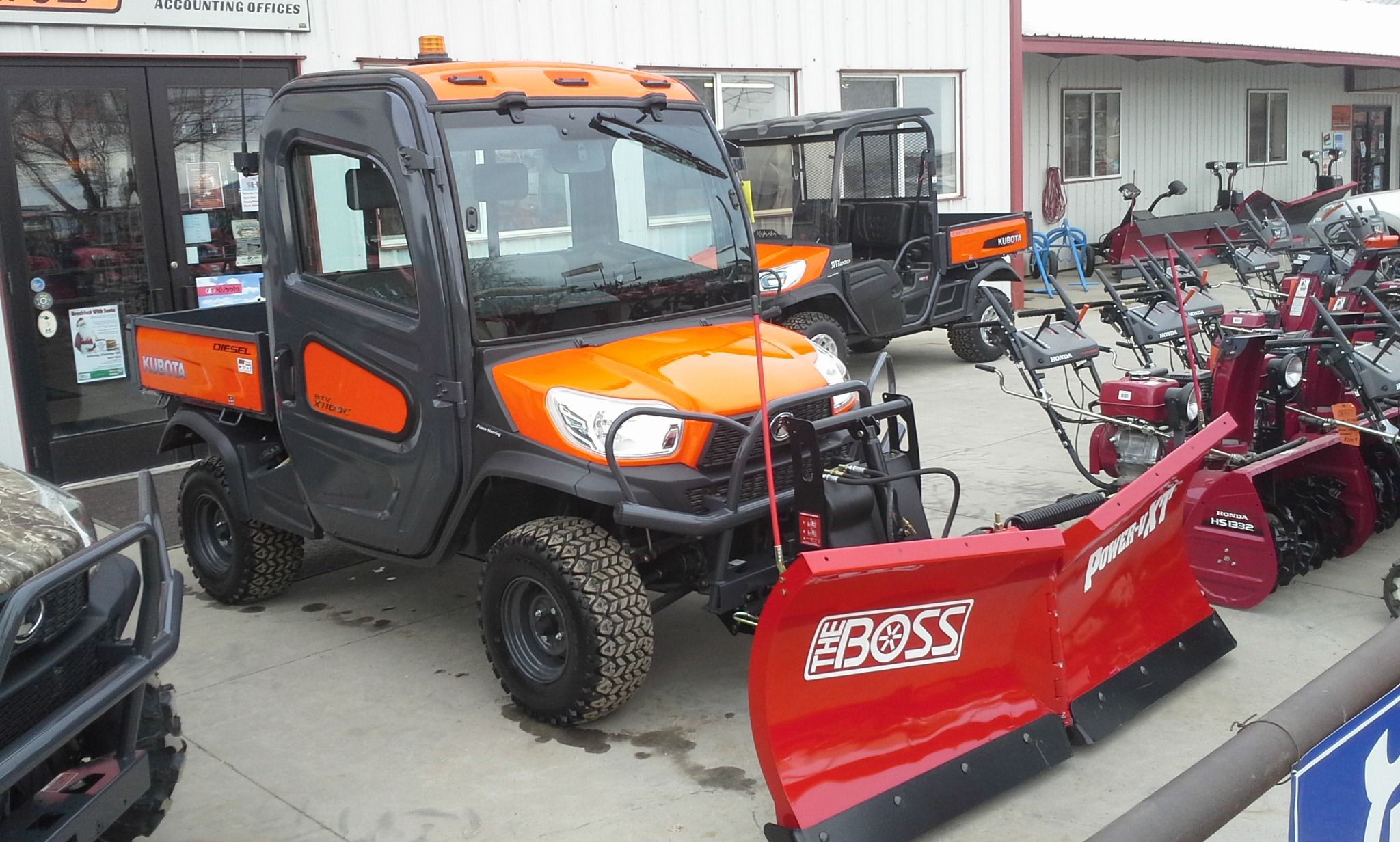 Kubota RTV with The Boss Power-V XT hydraulic front snow plow.
