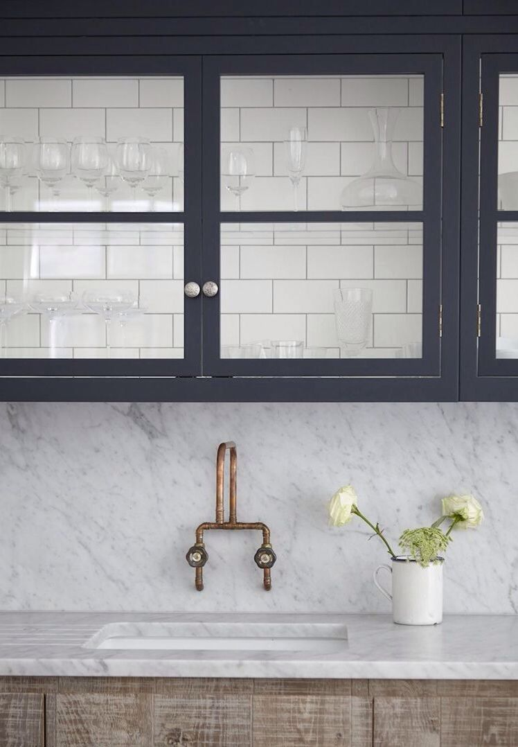 Carrara marble sink and counter top charcoal painted glass upper