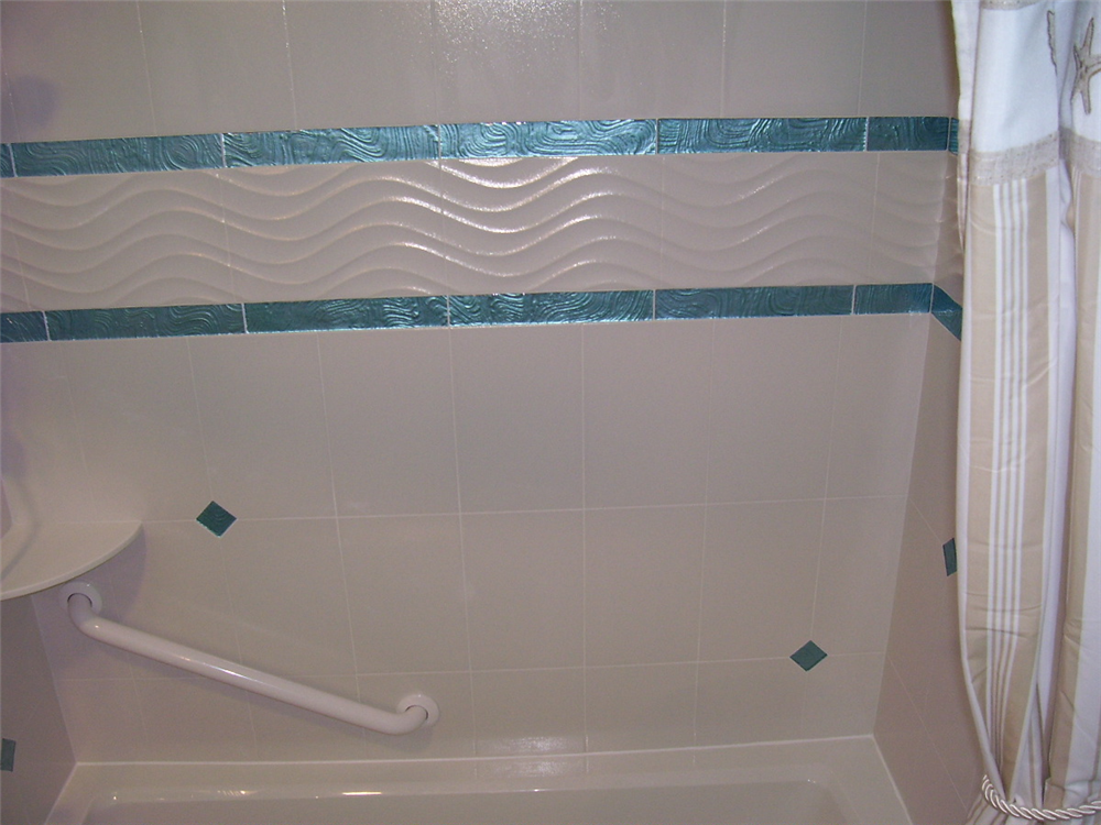 Coastal Bathroom Tile Ideas: White Wavy Tile And Iridescent Turquoise Border Tile Are