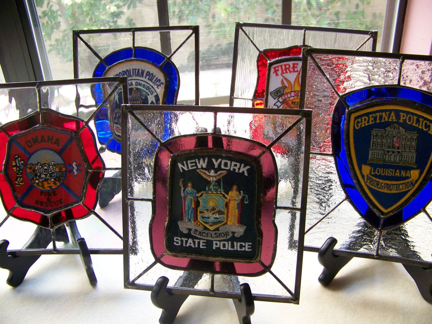 Custom made stained glass police and fire patch panels