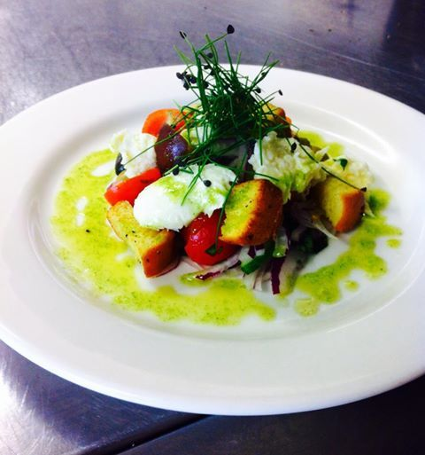 Panzanella salad of mozzarella, cherry tomatoes, basil, olives and brioche croutons.