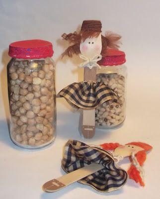 Vasetti di vetro con bambolina