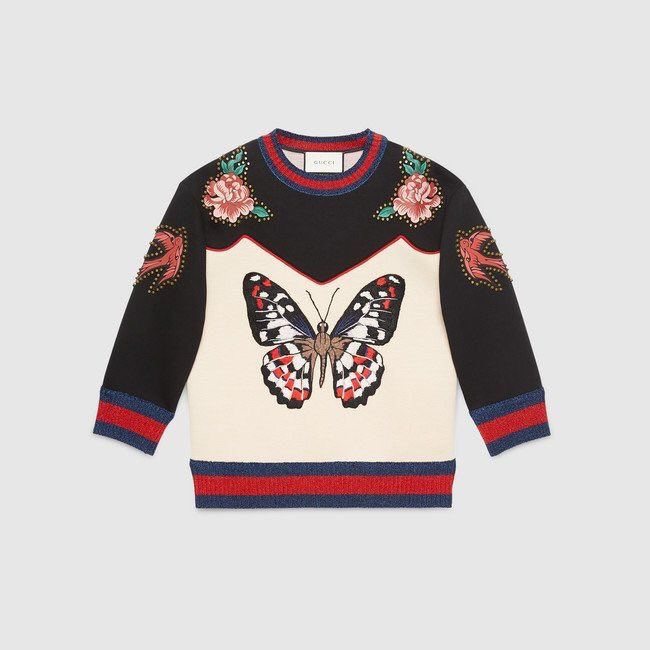 04bb3fb2fa1 Gucci designed a sweater inspired by Harry s tattoos!