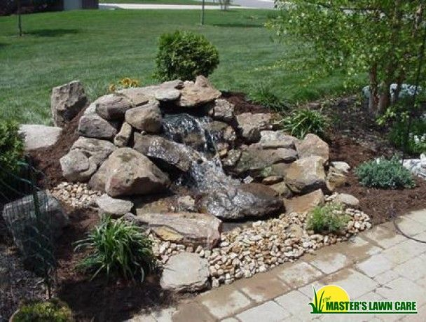 Pondless waterfall the masters lawn care back yard for Small pond care