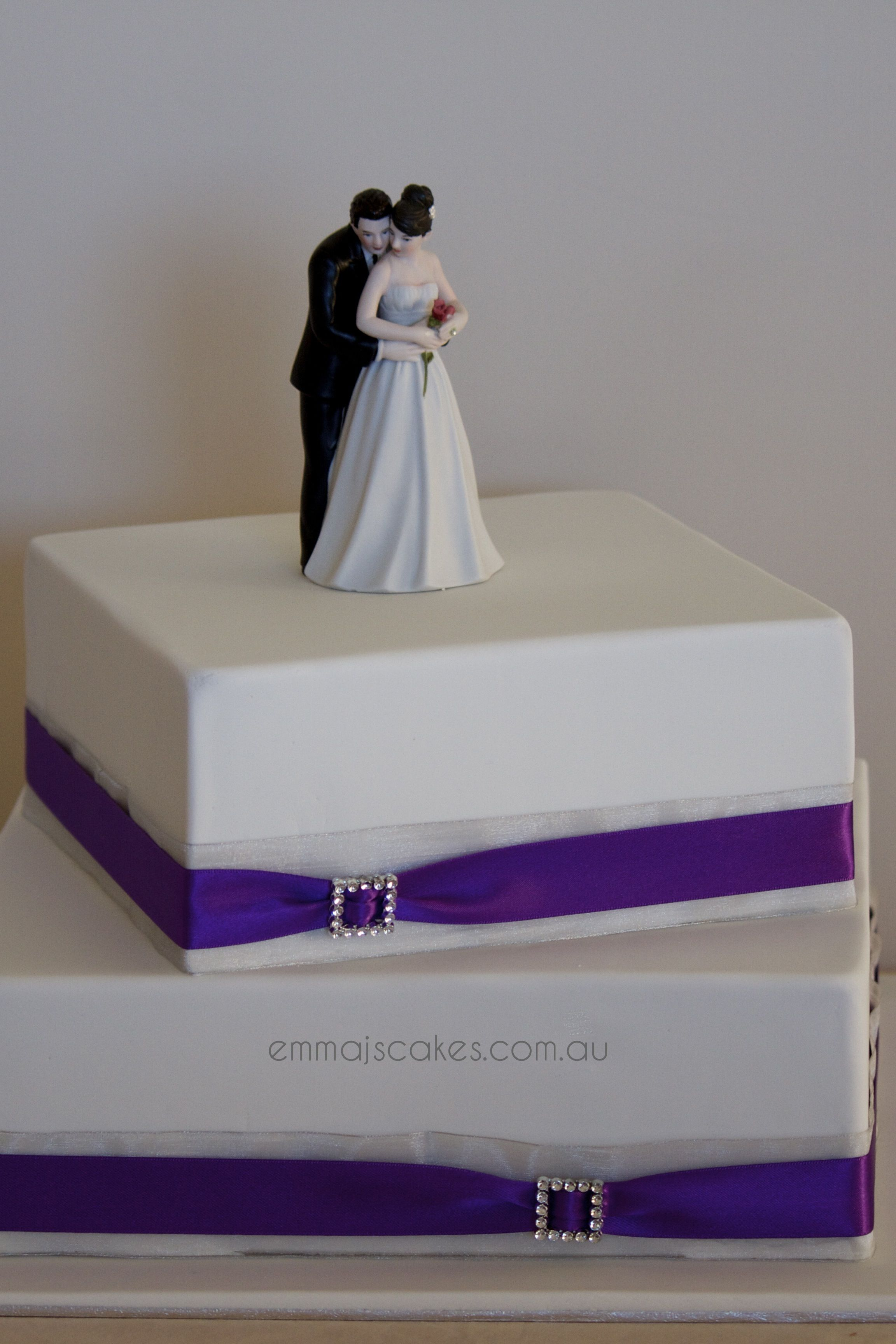 Two tier offset square purple and silver wedding cake