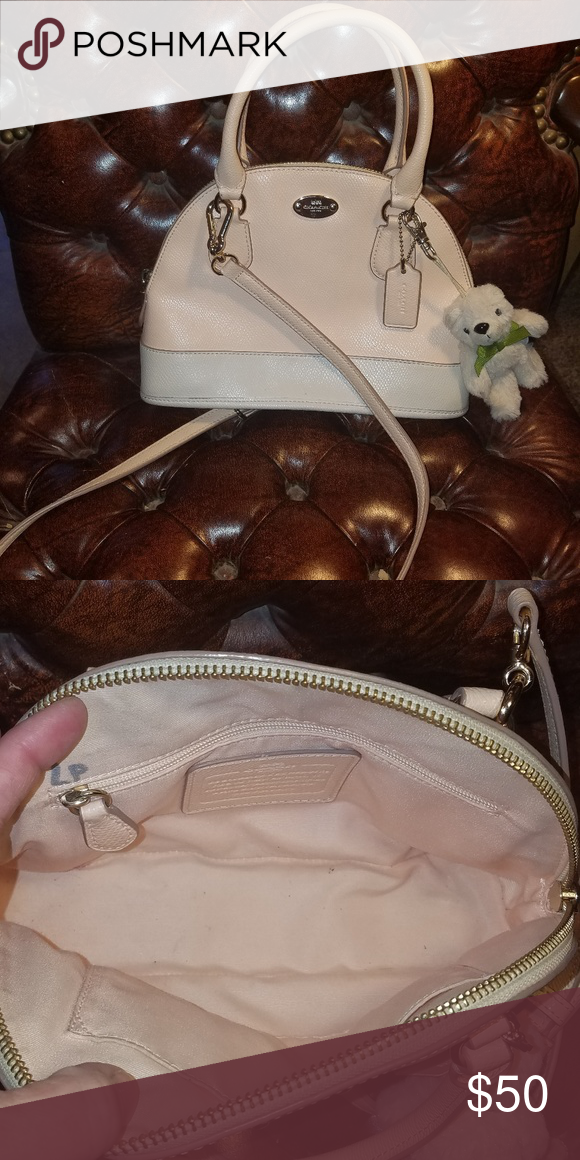 b98f2fbec7d7 Small Coach Bag Excellent used condition! Light pink and white in color.  Adjustable strap for shoulder wear. Has stuffed bear keychain too. Coach  Bags
