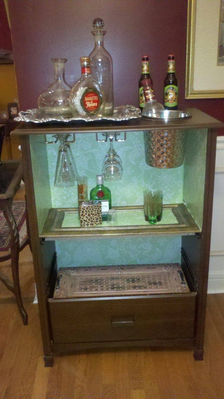 The bar I made from an old dresser. I cut a hole in the top for an ...