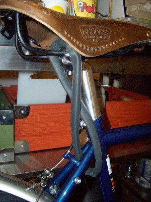 A Brooks Saddle Secured By A Bike Chain Seat Lock