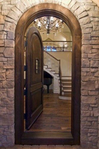 Arch Doorway Rustic Stone Facade Stone Wall Wood Flooring