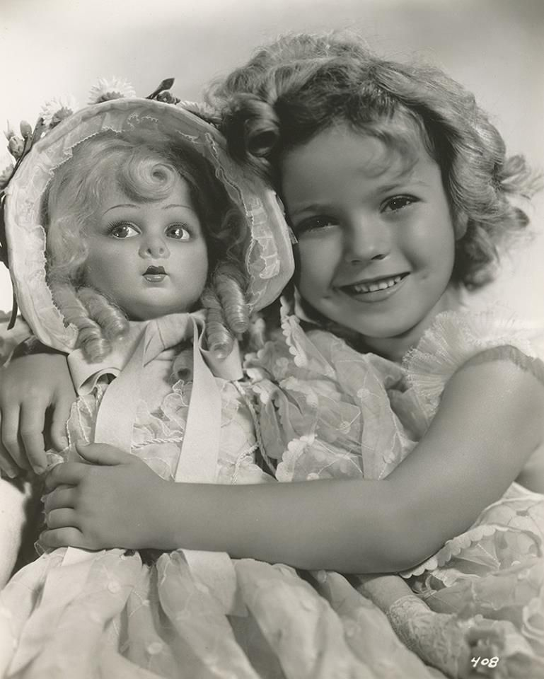 shirley temple with lenci doll pinkie from film bright eyes