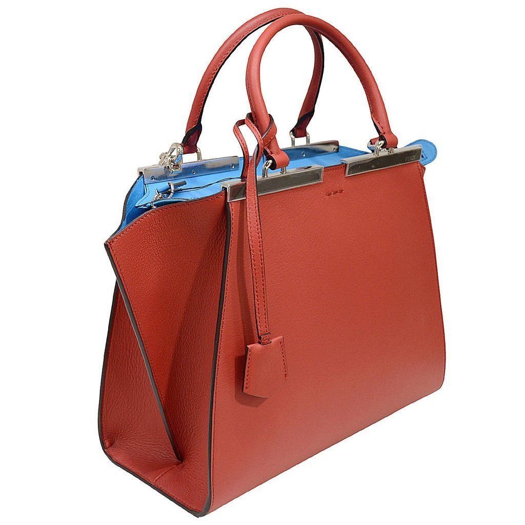b165e4f9faf Revive your style with this elegant shopper handbag from Fendi. This 3  Jours handbag has a winged design with silvertone plates and a dangling  logo tag.