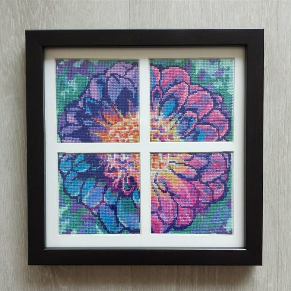 This post will show how to frame cross stitch and embroidery projects at home to save yourself time and money. It comes with a free downloadable graphic.