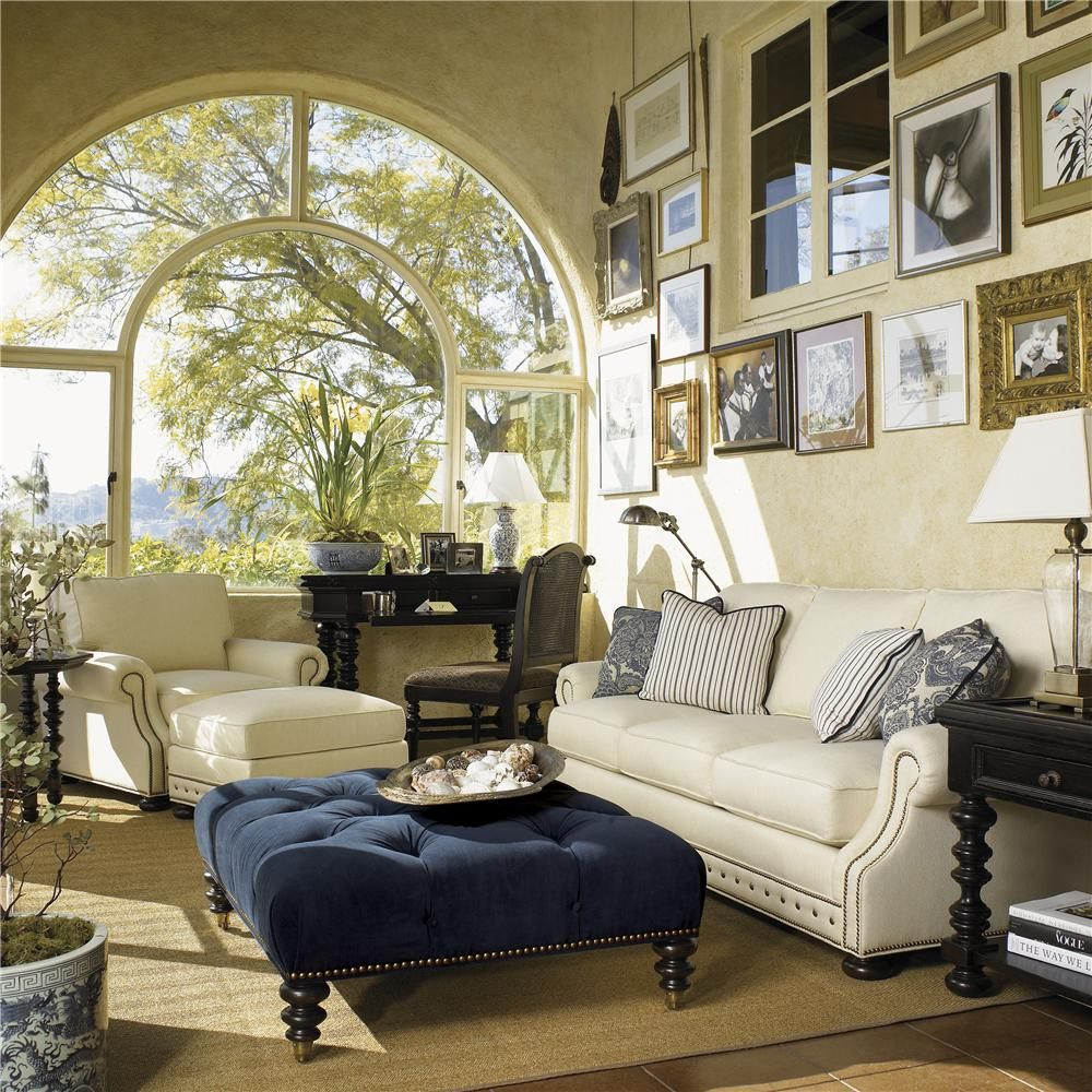 With the tall ceilings in their family room the gallery wall