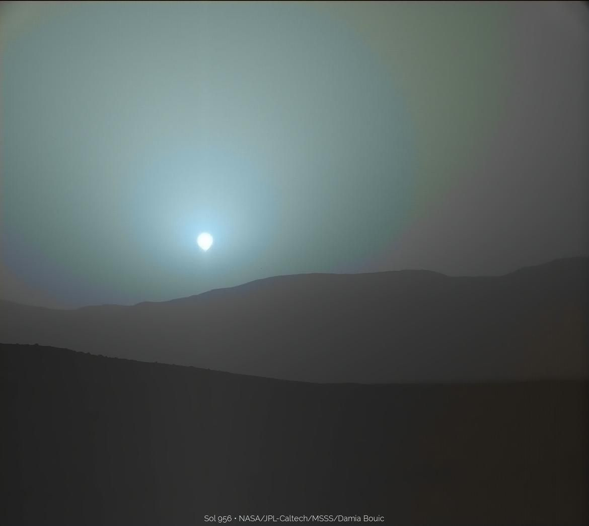Nothing makes Mars seem more alien than its sunset, which, in contrast to Earth sunsets, occurs in cool blue hues. This is because the thin Martian atmosphere contains dust particles that allow blue light to penetrate more efficiently when the sun is low on the horizon.
