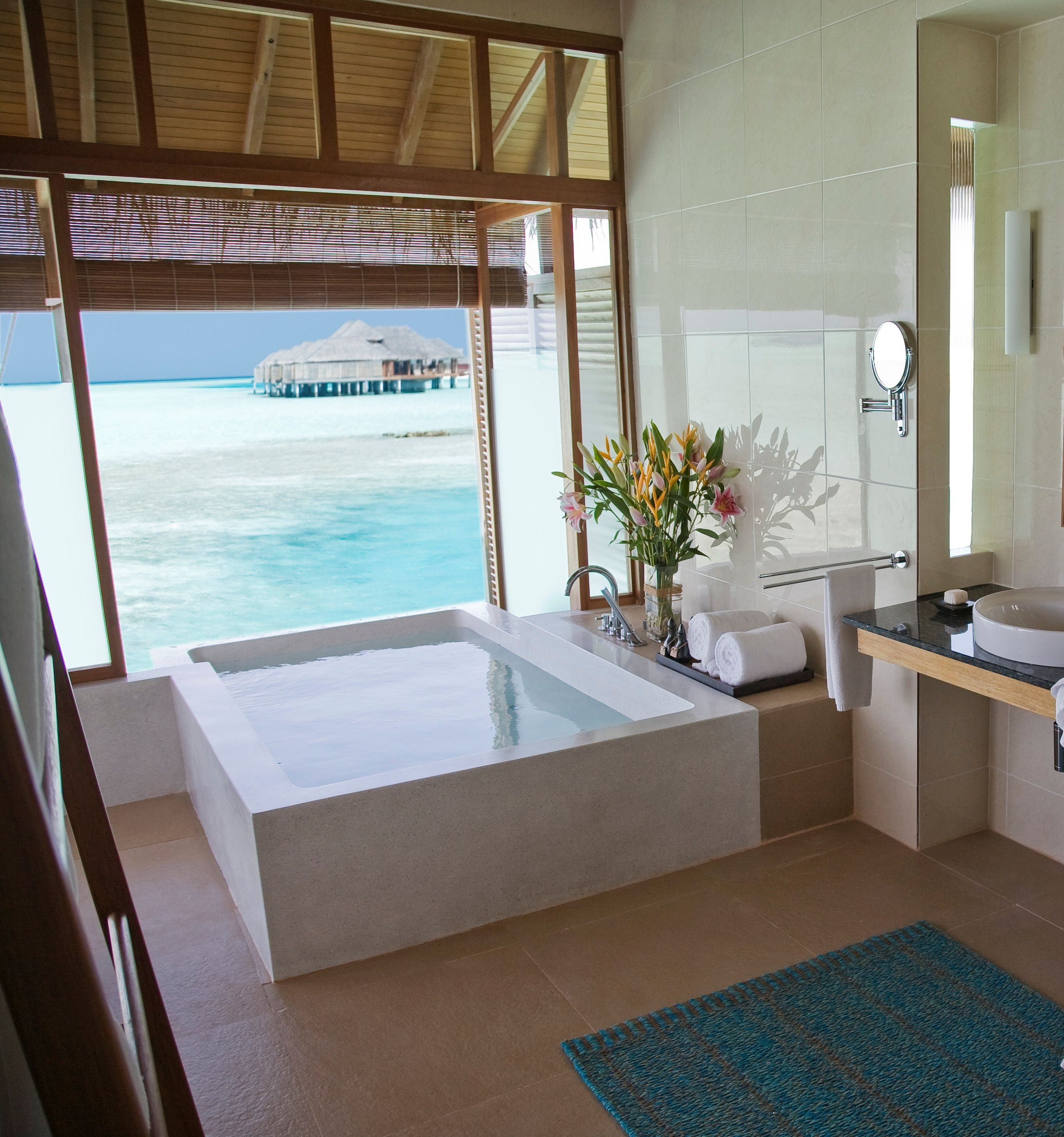Amazing sea view bathroom design in our over water for Bungalow bathroom designs
