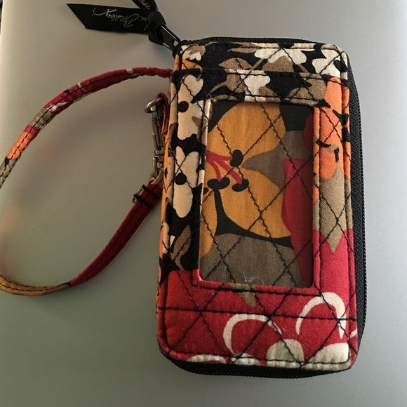 Vera Bradley Wristlet Wristlet with phone pocket on the back that fits an iPhone 5/5s & 5c or phones close to that size. Used for the summer so has some worn to it in the inside but still fabulous! It has an ID slot in the front. Vera Bradley Bags Clutches & Wristlets