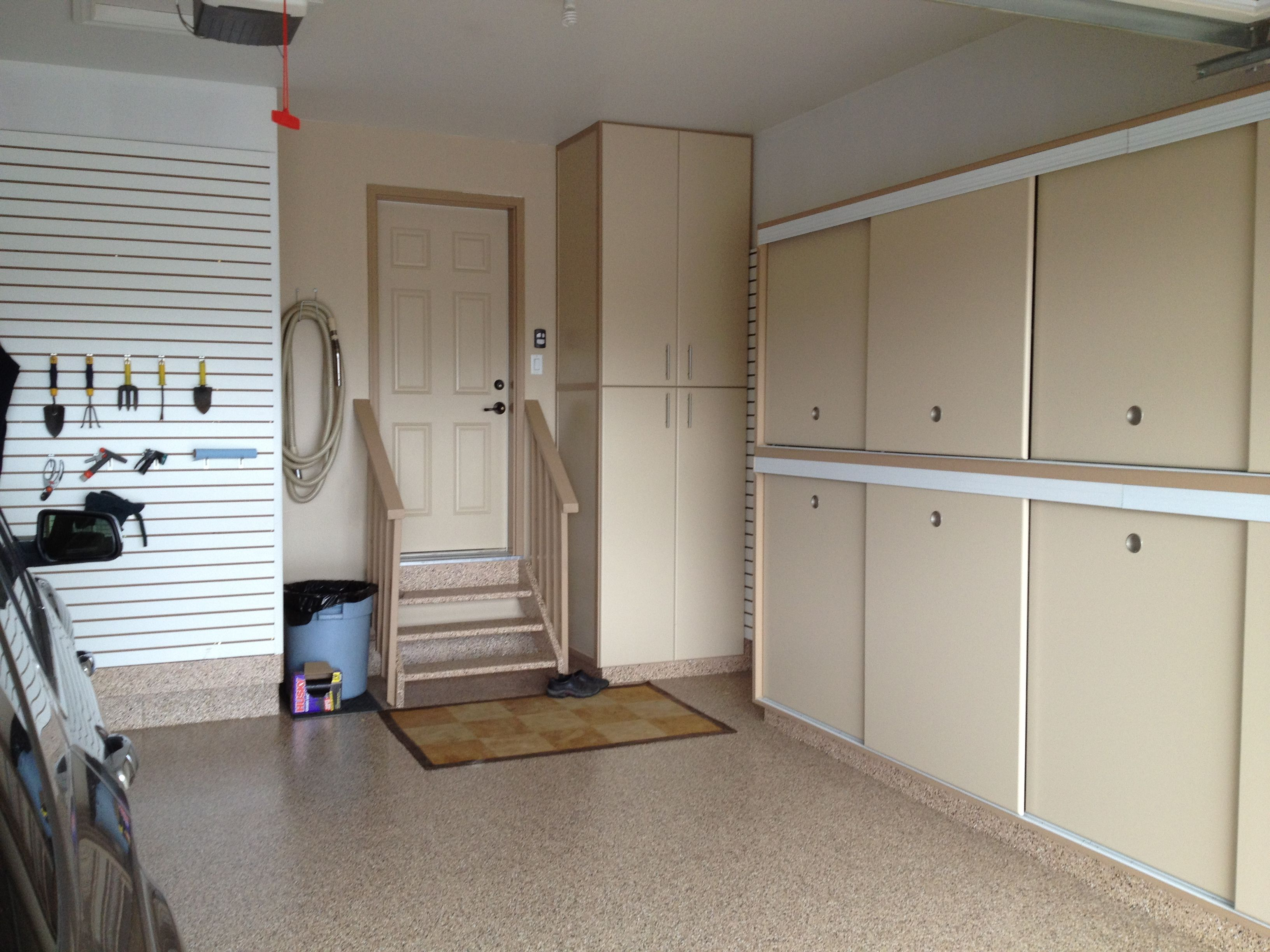 Gerry garage slotwall epoxy floor custom cabinets for Garage built ins