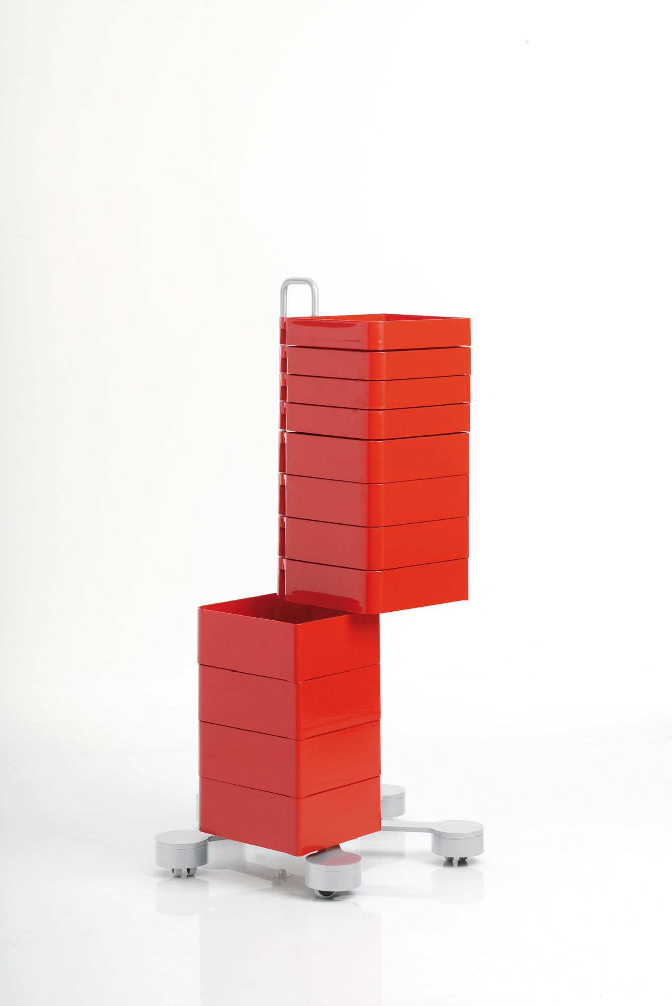 In injection-moulded ABS plastic with a structure in painted steel. The drawers can rotate up to 180°. Available also a fixed version for wall mounting. A design of Studio Joe Colombo, 2004.