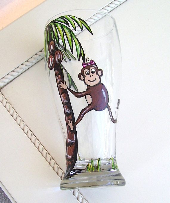 Playful monkey and palm tree pilsner glass brings a tropical feel to your table decor!! Choose from four different designs of hand painted monkeys!! Two boy choices with or without bow ties and two girls with or without head bows! This pilsner glass is hand painted in my Rose Artworks studio in a mixture of paint mediums using a special technique that allows you to view the painting from the inside and outside of the glass!! The glass is then baked for beauty and durability and can be put…