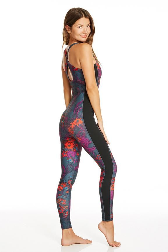 8640a1ef2a3d Be one and done in our romantic print jumpsuit. A built-in bra and slimming  side paneling make this statement piece your workout go-to.