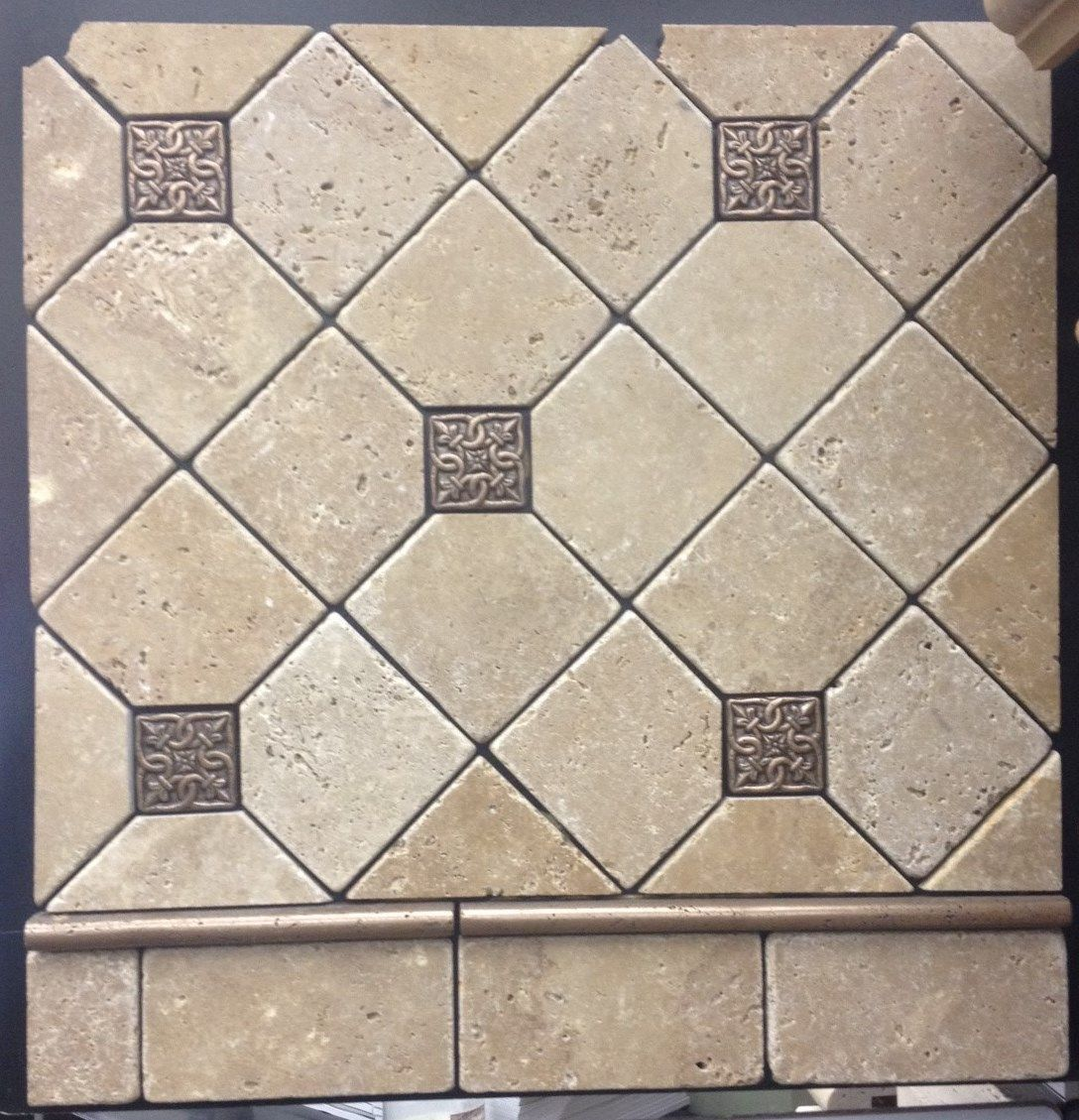 this TOPCU travertine field tile and metal inserts really add a ...