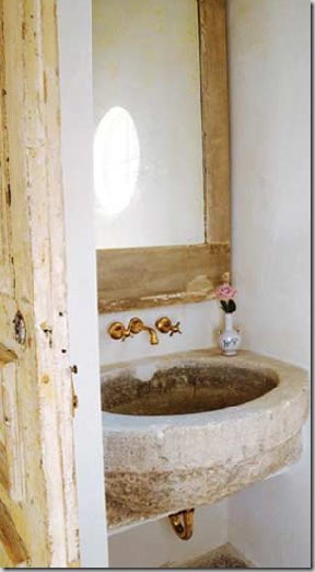 Example Of An Antique Stone Vessel Repurposed As A Sink.