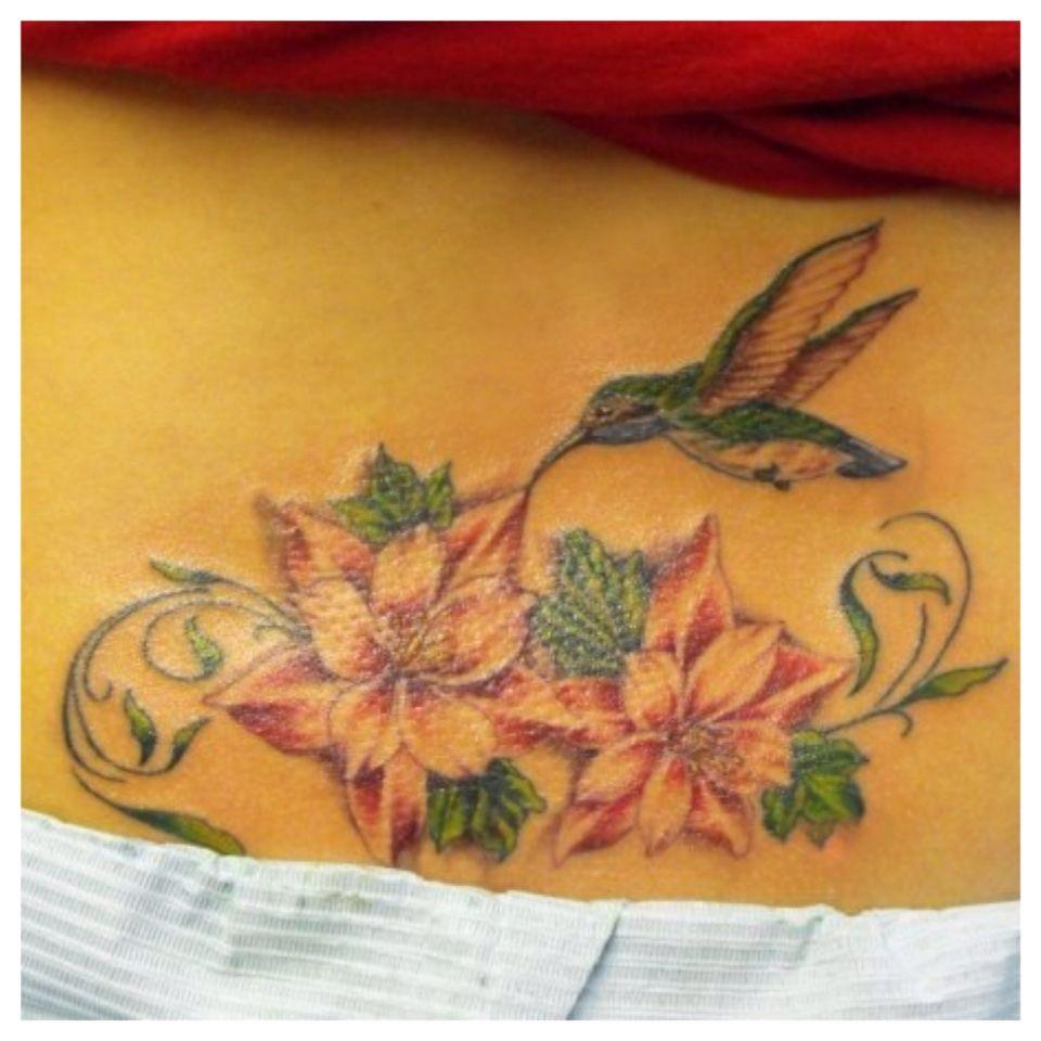 Hummingbird and flower tattoo on my lower back. Lower